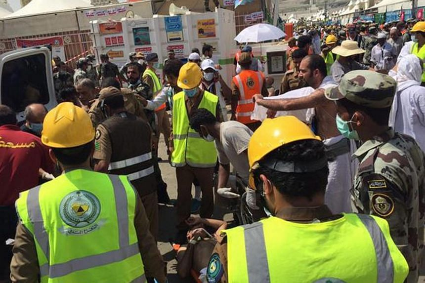 Members of Saudi civil defence trying to rescue pilgrims following a crush caused by large numbers of people pushing at Mina, outside the Muslim holy city of Mecca, on Sept 24, 2015.