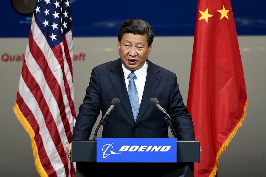 Chinese President Xi Jinping speaking after his tour of the Boeing assembly line in Everett, Washington on Sept 23, 2015.