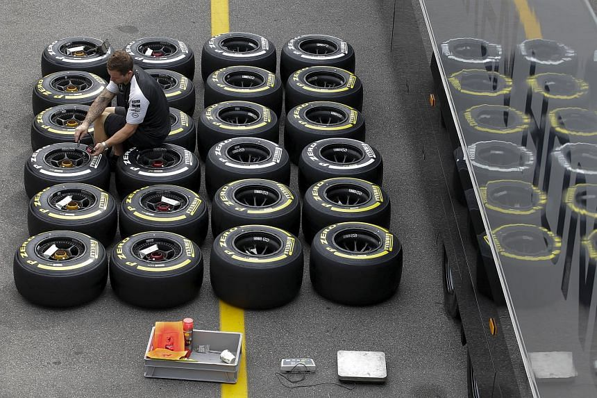 A Mercedes mechanic checks the pressure of Pirelli tyres ahead of the Italian F1 Grand Prix in Monza on Sept 3, 2015.
