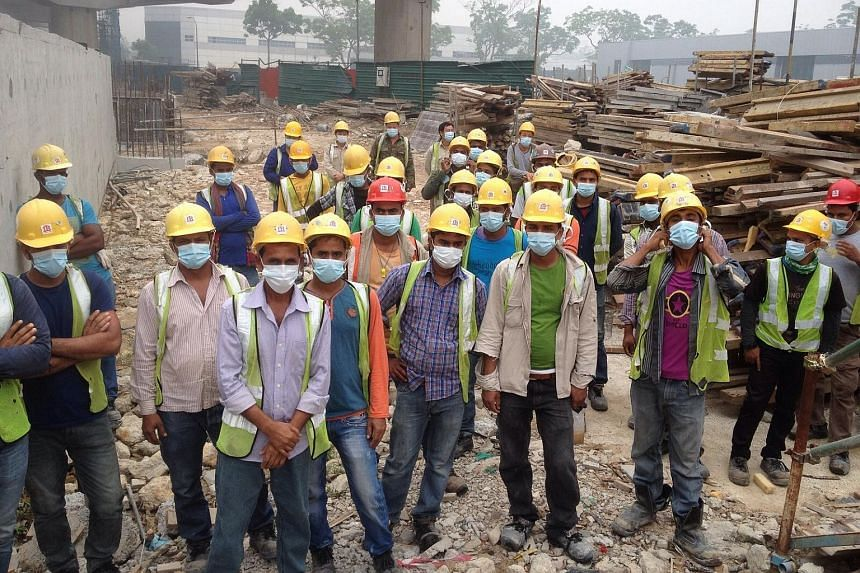 Construction workers of Chong Brothers General Contractor were given masks when they turned up for work on Friday morning.