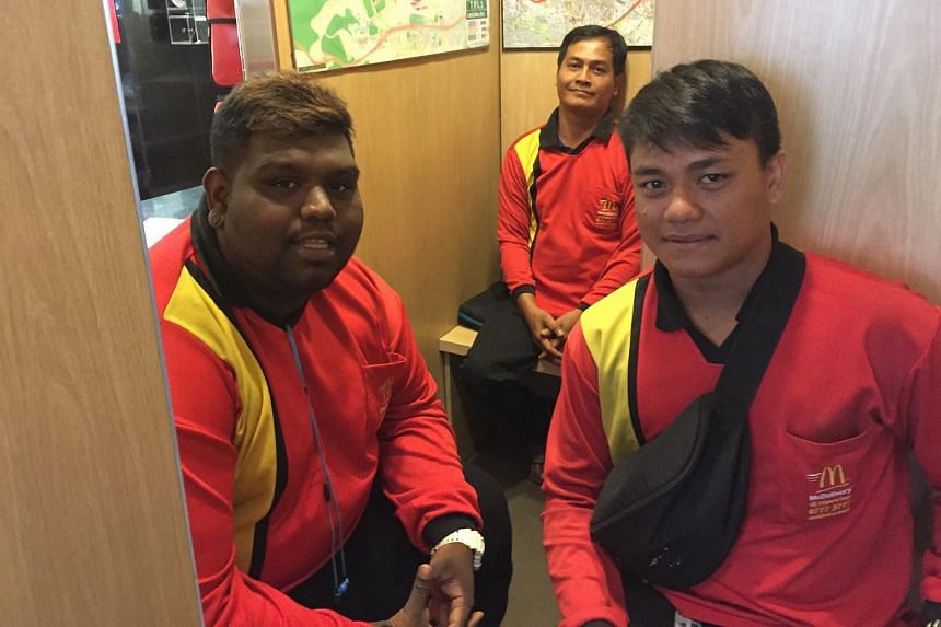 From left: McDonald's delivery riders Vicknesh, 24, Rosli, 47 and Mohammed Azmi, 27, turned up for work at an outlet at Toa Payoh this morning.
