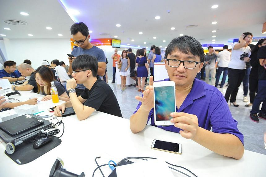Mr Wang Youwen, 38, an operations executive, is the first customer to get an iPhone 6S Plus.