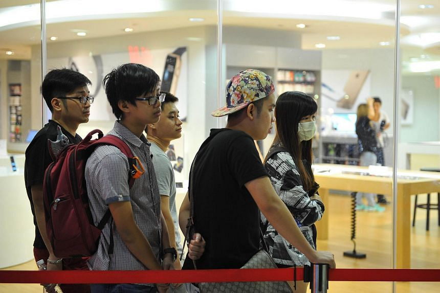 The queue for the iPhone 6S outside epiCentre at ION Orchard.