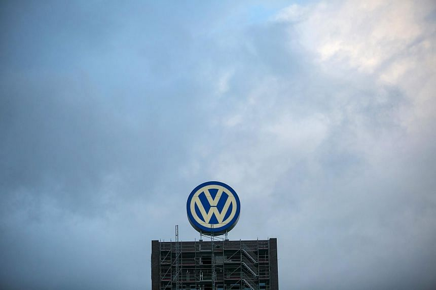 A VW logo sits above a building under construction at the Volkswagen AG headquarters in Wolfsburg, Germany.