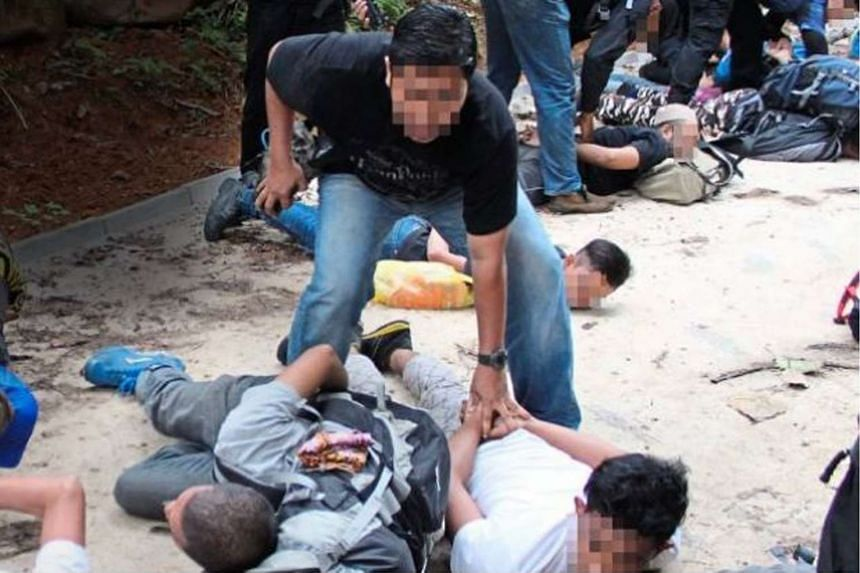 Malaysia's Counter Terrorism Division detaining 11 men, suspected to be Islamic state in Iraq and Syria militants, in this April 25, 2015 file photo.