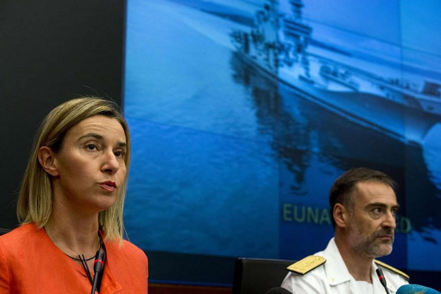 High Representative for Foreign Affairs Federica Mogherini (left) and Commander of EU NAVFOR MED Enrico Credendino (right) during a press conference at the headquarters of EU NAVFOR MED in Rome, Italy, on Sept 24, 2015.