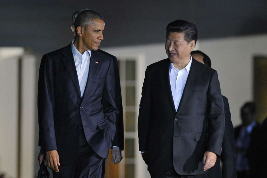 US President Barack Obama (left) and China's President Xi Jinping (right) walk from the White House and across Pennsylvania Avenue to Blair House, the president's official guest house.