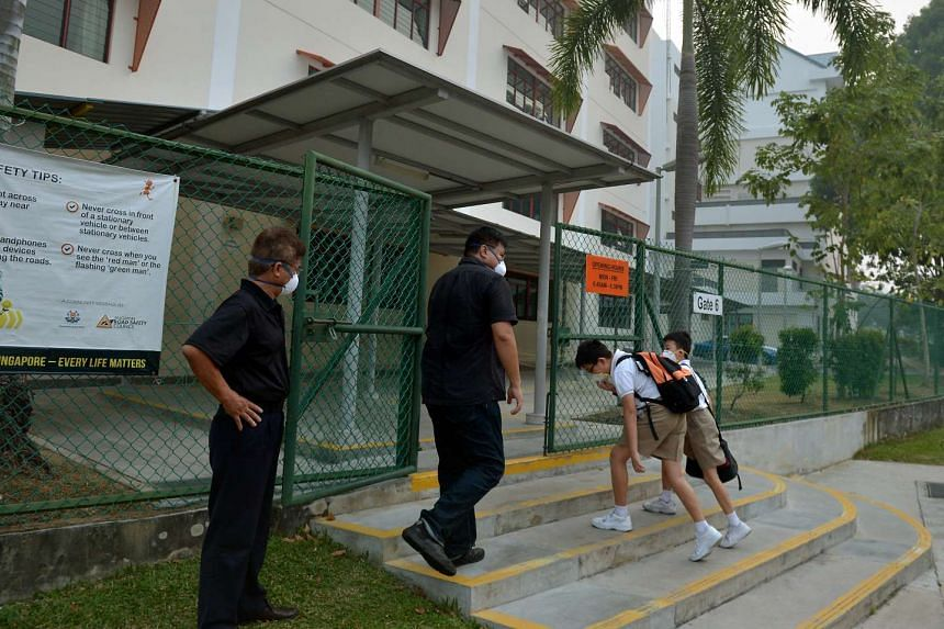 Two students arriving at Kong Hwa School after 7am on Sept 25, 2015.
