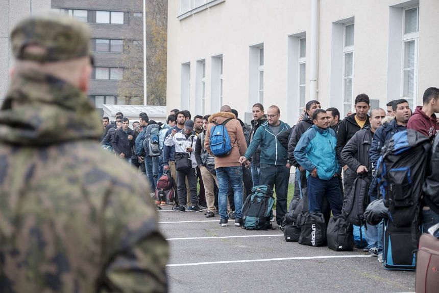 Asylum seekers arrive at a refugee reception centre in Finland on Sept 25, 2015.