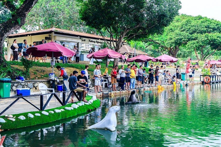 Administrative executive Amanda Kartini fishes nearly every weekend with her fiance at the pond in Neo Tiew Crescent. Ready, Get Set, Cast! will be held at the Pasir Ris Fishing Pond in Pasir Ris Town Park (left) tomorrow and the fishing pond in Orto