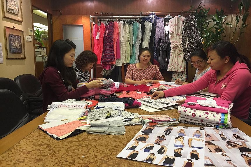 Ms Janice Tan (centre), general manager of textile and garments trader Tantex, at a meeting with her staff. She attributes the company's success to the good partnership and alliances that it forms with manufacturing plants in South-east Asia.