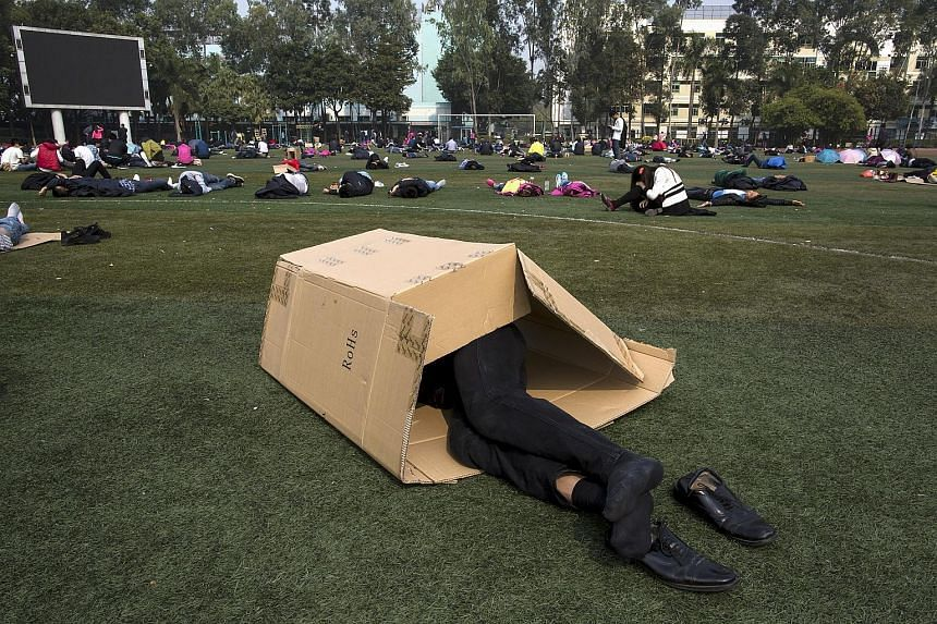 A worker taking a nap during lunch break at a Foxconn factory in the township of Longhua in Shenzhen. UBS global economist Paul Donovan says a popular misconception is that China is an engine of global growth. According to him, that honour belongs to