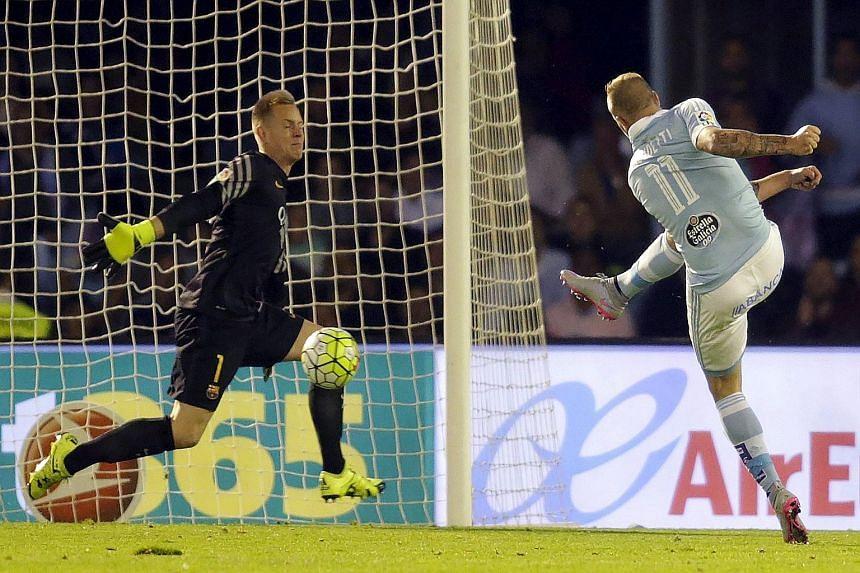 John Guidetti slamming the ball past goalkeeper Marc-Andre Ter Stegen for Celta Vigo's fourth goal in their 4-1 home win over Barcelona.