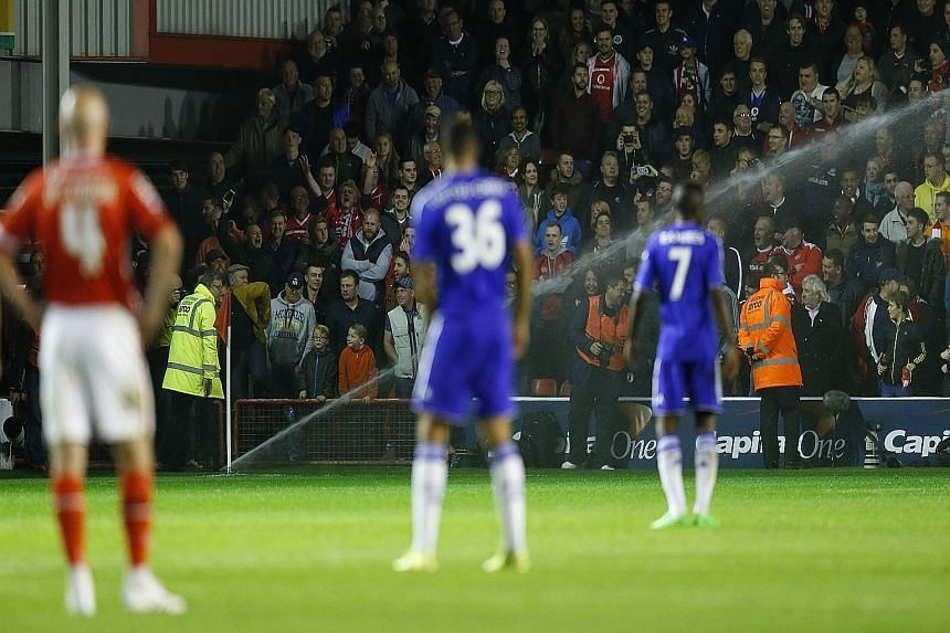 Players and fans are bemused as sprinklers came on to water the pitch during the League Cup third-round match between Walsall and Chelsea. The interruption did not stop the Blues from cruising to a 4-1 away win.