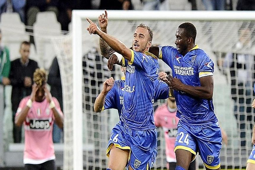 Frosinone's Leonardo Blanchard (second from right) celebrating with his team-mates after scoring against Juventus to earn the Serie A newcomers' first-ever point in the Italian top-flight.