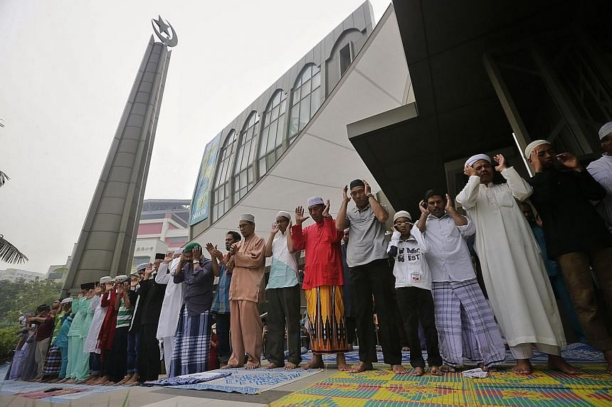 Worshippers at Al-Mawaddah Mosque praying on Hari Raya Haji yesterday. At the mosque in Sengkang, 224 lambs were sacrificed and a portion of the meat was given to 114 needy families.