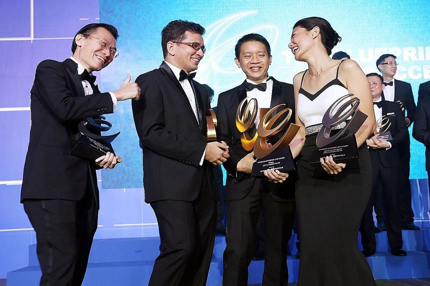 (From left) Mr Oliver Tan of ViSenze, Dr Charles Johnson of Hope First Response, Mr Ven Chin of GD Group and Ms Cecilia Chow of Zweec Analytics, with their trophies on Wednesday night. Zweec Analytics also bagged the Best Innovation Award and ViSenze