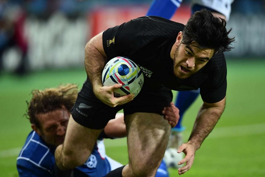 New Zealand's wing Nehe Milner-Skudder scores a try.