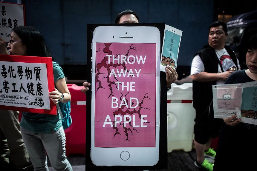 Rights campaigners stage a protest coinciding with the launch of the new iPhone 6s outside an Apple store in Hong Kong on Sept 25, 2015.
