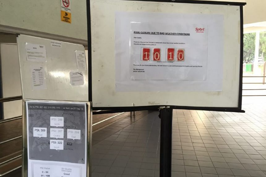 Signages put up at Bedok Swimming Complex notifying the public about temporary pool closure due to the haze. ST PHOTO: NEO XIAOBIN