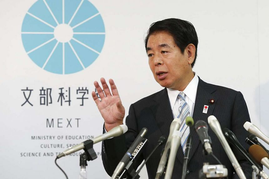 Japan's sports minister Hakubun Shimomura speaks before press at his office in Tokyo on September 25, 2015 after a cabinet meeting.