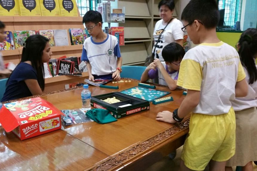 Pupils at De La Salle Primary School playing games such as Scrabble and Bingo.