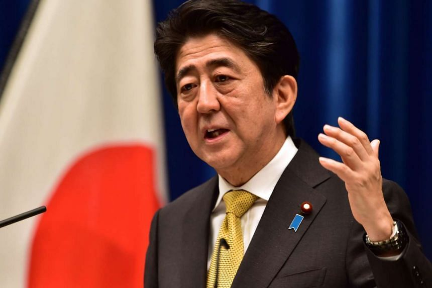 Japanese Prime Minister Shinzo Abe may creak open his country's notoriously tight immigration policy by accepting some refugees fleeing fighting in war-torn Syria, according to local media.