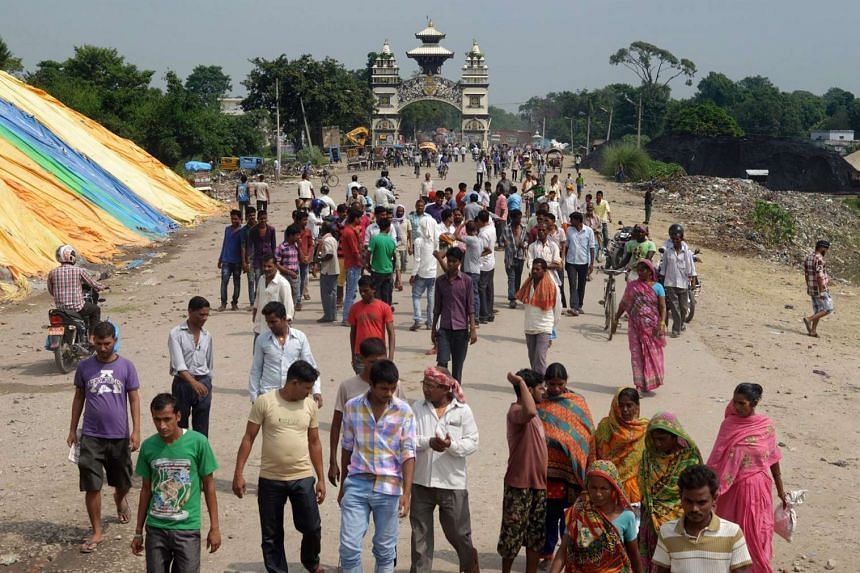 Hundreds of protesters blocked a major trading checkpoint between India and Nepal, cutting off vital supplies.