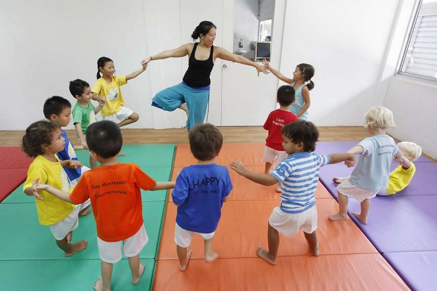 Preschoolers at Casa Montessori Internationale & Babies Inc participating in a lesson conducted by Om Shiva Yoga.