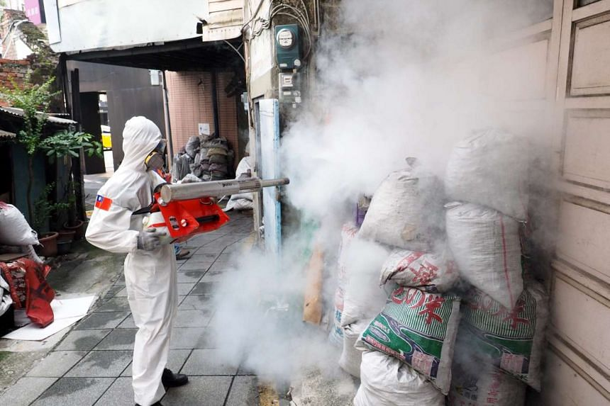 A residential area in Tainan being fumigated on Tuesday.