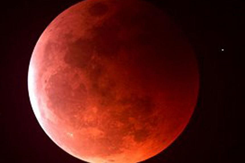 A rare blood moon sighted at mid-eclipse on June 15, 2011, during the longest total lunar eclipse in 10 years.