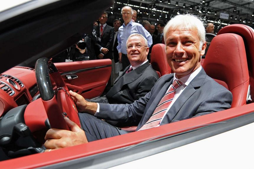Porsche unit chief Matthias Mueller in driver's seat) has been named as a possible successor to discredited Volkswagen CEO Martin Winterkorn (seated beside him).