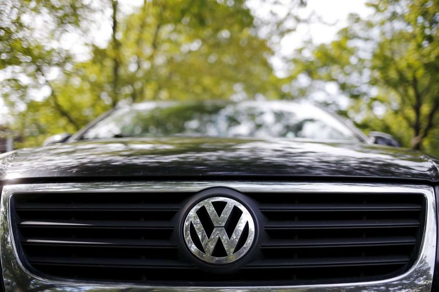 The logo of German carmaker Volkswagen is seen on the front grill of a Passat car.