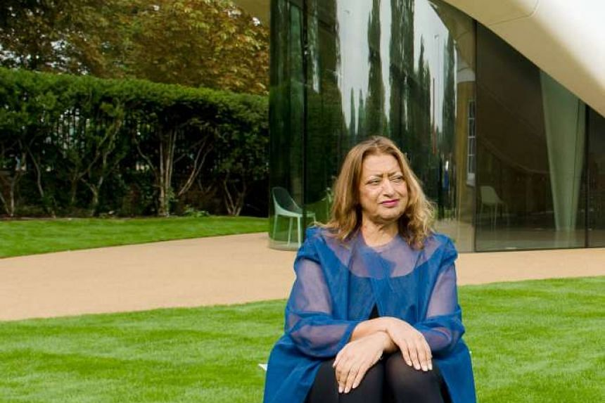 Zaha Hadid posing for pictures outside her recently completed design for an extension of the Serpentine Sackler Gallery in London.