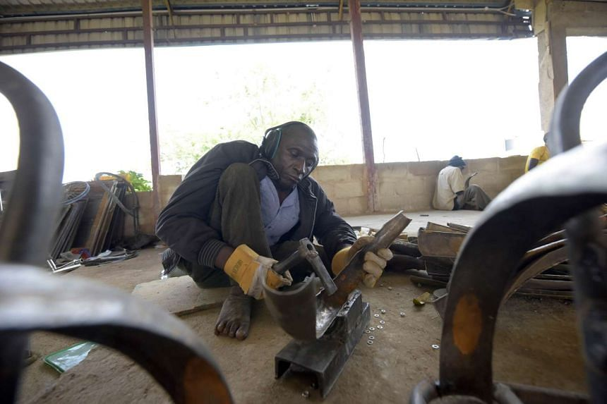 At the Beautiful Gate Handicapped People's Centre in Jos, northcentral Nigeria Plateau State, Nigerian polio survivors such as Emmanuel Ahamadu  spend the day bending, sawing, bashing and welding metal.