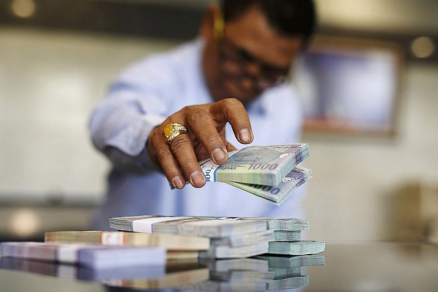 The rupiah saw its steepest weekly drop in almost two years amid worsening growth and signs that the US will raise interest rates this year.