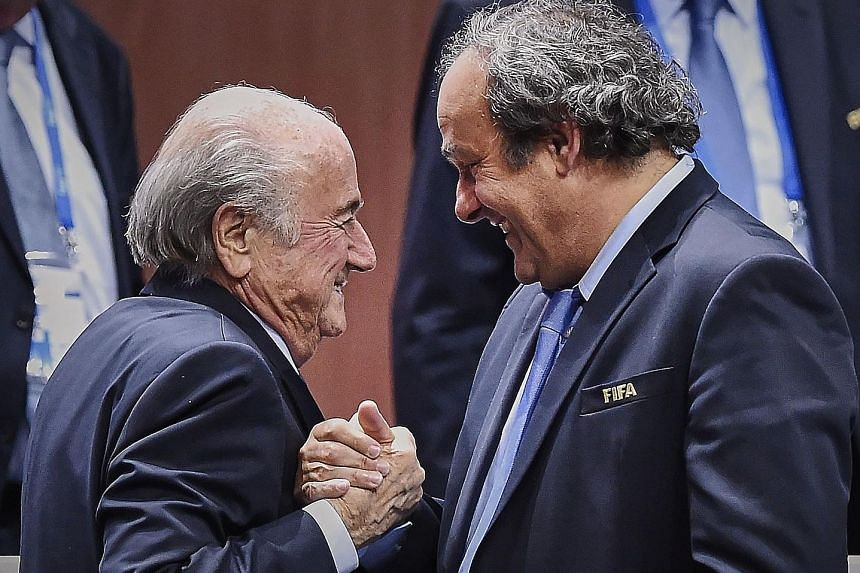 Sepp Blatter (far left, with Michel Platini) has cut a lonely figure since Fifa became embroiled in a corruption scandal. He has always denied wrongdoing and was set to step down as president next year.