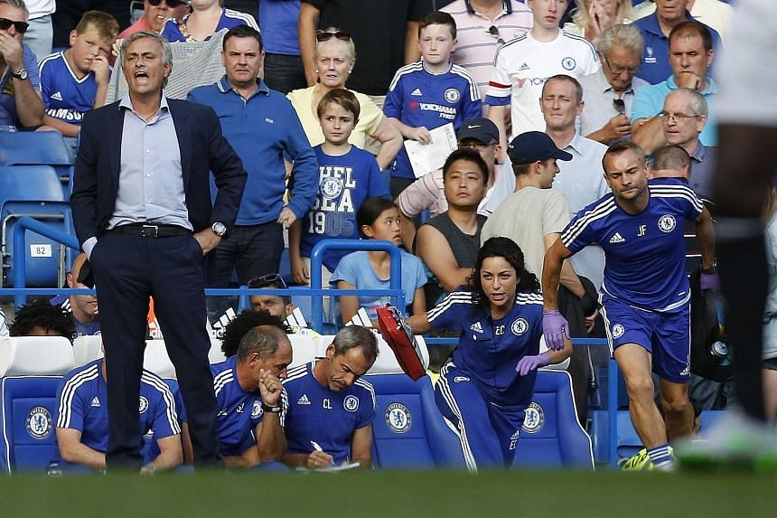 Chelsea manager Jose Mourinho (far left) lost his cool after the team's doctor Eva Carneiro and head physio Jon Fearn (right) rushed off the bench to treat midfielder Eden Hazard during their English Premier League football match against Swansea on A