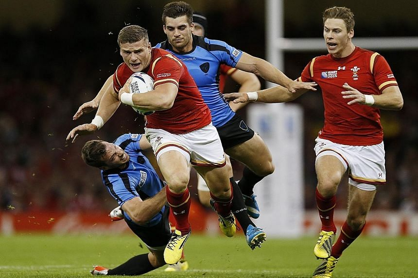 Wales' Williams (with ball in tie against Uruguay) and Roberts have more experience than England's Burgess and Barritt in midfield.