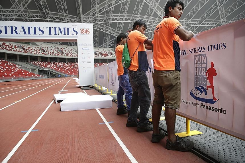 The Straits Times Run At The Hub race village being set up inside the National Stadium. A host of activities awaits runners afterwards.