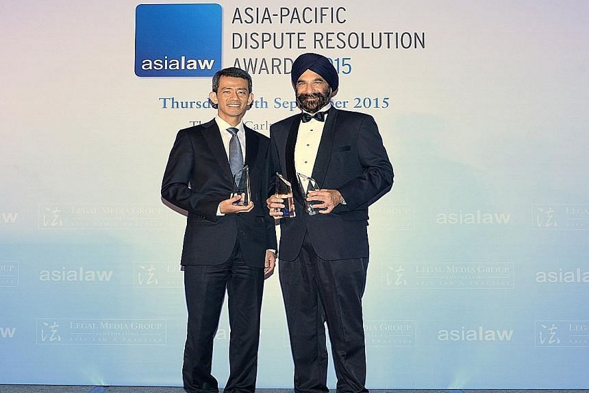 """Senior Counsel Davinder Singh (right) was named Singapore's """"Disputes Star of the Year"""" at a Hong Kong event. Senior Counsel Cavinder Bull received Drew & Napier's awards."""
