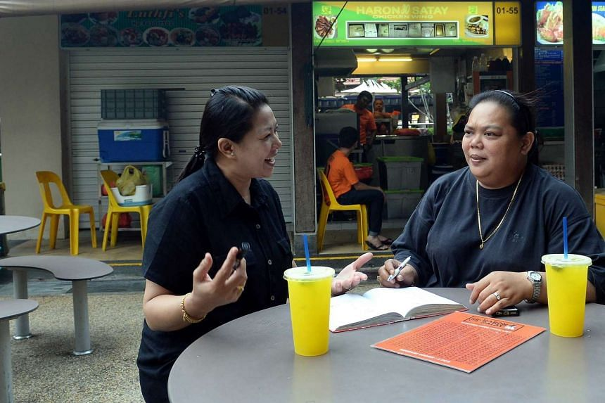 Owners of Haron Satay at East Coast Lagoon Food Village, Ms Harlina Haron (right) and Ms Shima Salim observed that the haze has mauled outdoor eateries, with stallholders pointing out that the number of customers has dwindled in the recent weeks.