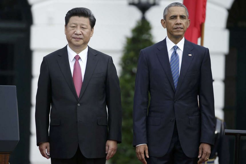 US President Barack Obama (right) stands with Chinese President Xi Jinping during an arrival ceremony at the White House on Sept 25, 2015.