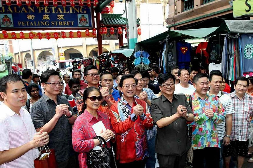 Malaysia is expected to summon China's ambassador Dr Huang Huikang (centre, in red) on Monday over his statements made during his visit to Petaling Street on Friday.