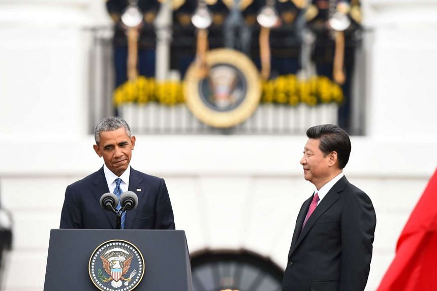 President Barack Obama and his Chinese counterpart Xi Jinping during the official welcoming ceremony at the White House yesterday. Mr Xi was given a 21-gun salute and a ceremonial state dinner. The two leaders also held more casual talks at an earlie