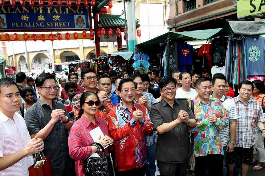 Dr Huang Huikang (in red batik shirt), China's envoy to Malaysia, during his visit to Petaling Street on Sept 25 2015.