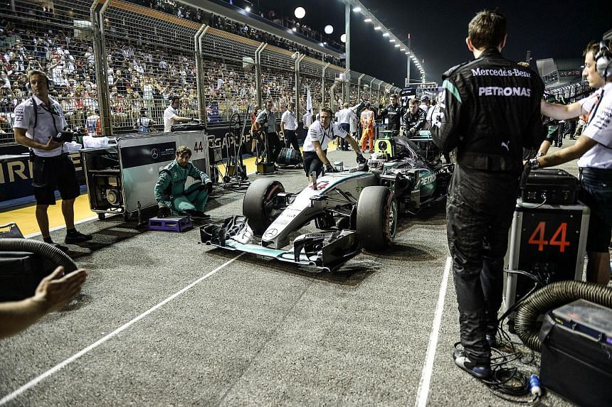 Mercedes AMG Petronas F1 Team's British driver Lewis Hamilton car is seen prior to the start of the Formula One Singapore Grand Prix in Singapore on Sept 20, 2015.
