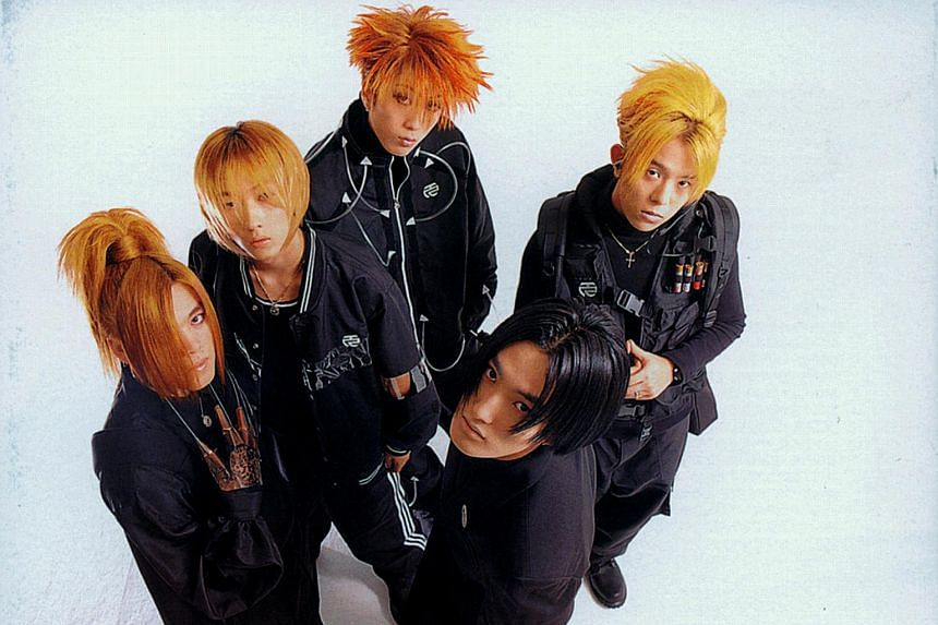 Members of the iconic 90s K-pop boy band H.O.T are (clockwise, starting from extreme left) Hee Jun, Woo Hyuk, Jae Won, Tony An and Kang Ta (with black hair).
