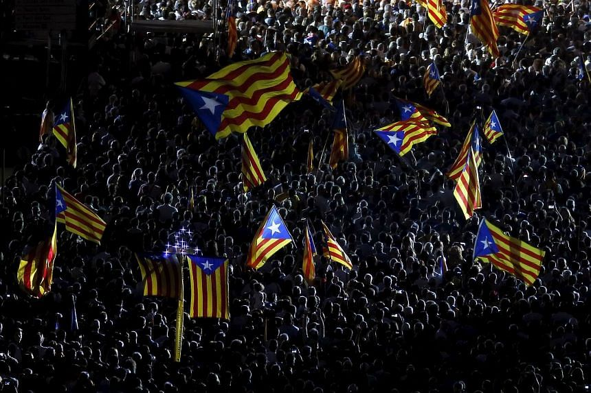 "Estelades (Catalan separatist flag) flags fly during the last meeting of Catalan Pro-independence party ""Junts pel si"" in Barcelona, Spain, on Sept 25, 2015."