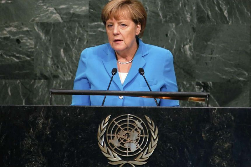 German Chancellor Angela Merkel addresses a plenary meeting of the United Nations Sustainable Development Summit 2015 at United Nations headquarters in Manhattan, New York, on Sept 25, 2015.